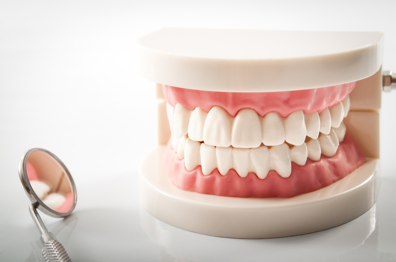 Dentures or Dental Implants? Which One is Right for Me? | Dental Remedies
